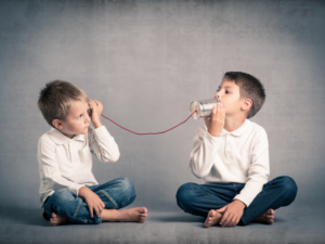 children with soup can phone